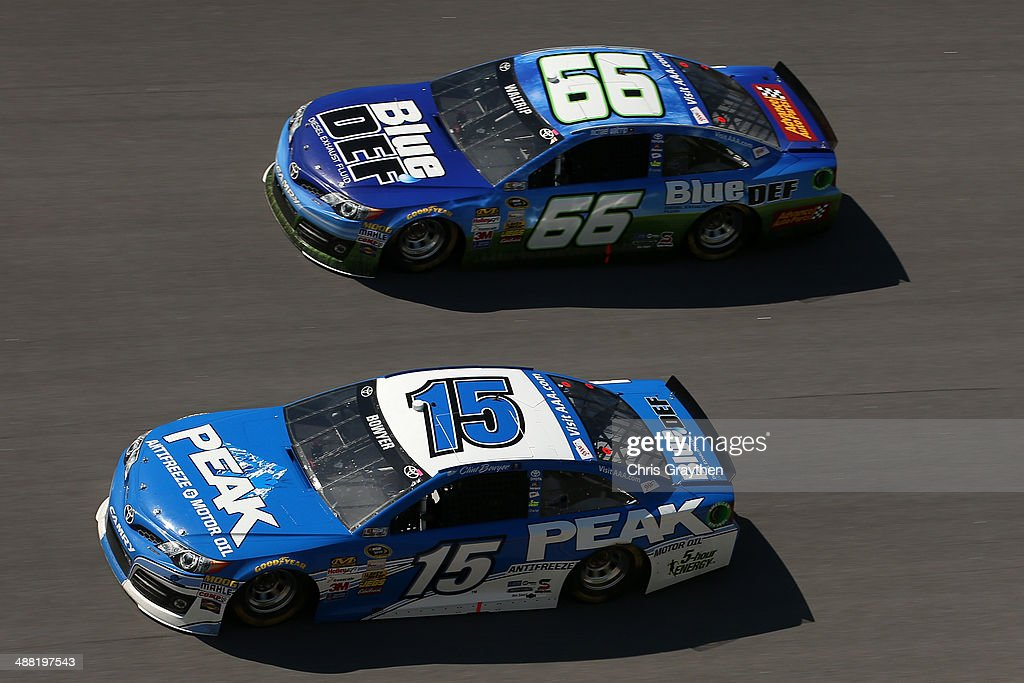 Clint Bowyer, driver of the #15 PEAK Antifreeze / Motor Oil Toyota, leads Michael Waltrip, driver of the #66 Blue / DEF Toyota, during the NASCAR Sprint Cup Series Aaron's 499 at Talladega Superspeedway on May 4, 2014 in Talladega, Alabama.