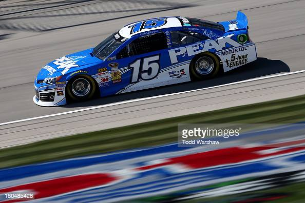 Clint Bowyer driver of the Peak Antifreeze Toyota practices for the NASCAR Sprint Cup Series Geico 400 at Chicagoland Speedway on September 13 2013...