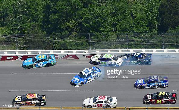 Clint Bowyer driver of the PEAK Commercial Industrial Toyota Casey Mears driver of the GEICO Chevrolet and Ricky Stenhouse Jr driver of the Fifth...