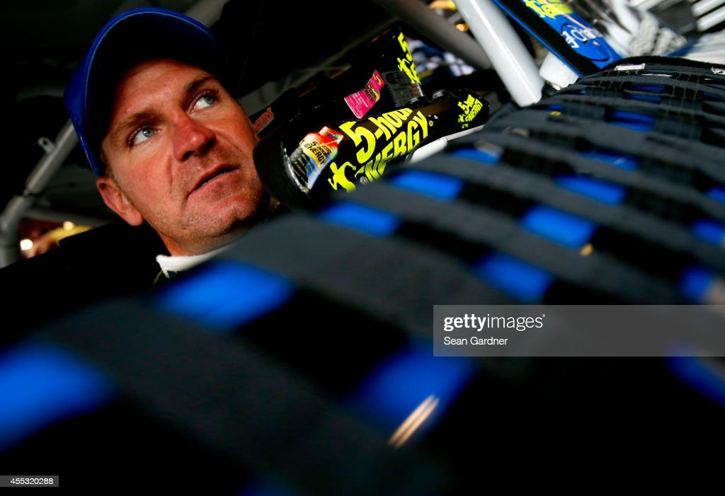 <a gi-track='captionPersonalityLinkClicked' href=/galleries/search?phrase=Clint+Bowyer&family=editorial&specificpeople=537951 ng-click='$event.stopPropagation()'>Clint Bowyer</a>, driver of the #15 PEAK Radiator Guarantee Toyota, sits in his car during practice for the NASCAR Sprint Cup Series MyAFibStory.com 400 at Chicagoland Speedway on September 12, 2014 in Joliet, Illinois.