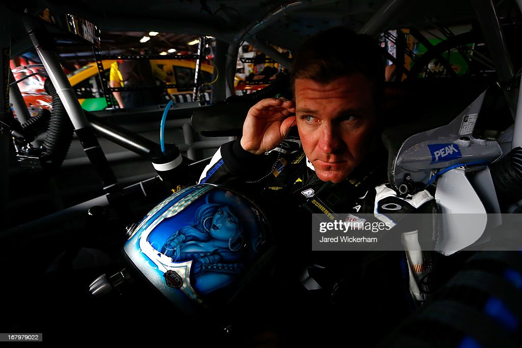 Clint Bowyer, driver of the #15 Peak Toyota, in the garage area during practice for the NASCAR Sprint Cup Series Aaron's 499 at Talladega Superspeedway on May 3, 2013 in Talladega, Alabama.