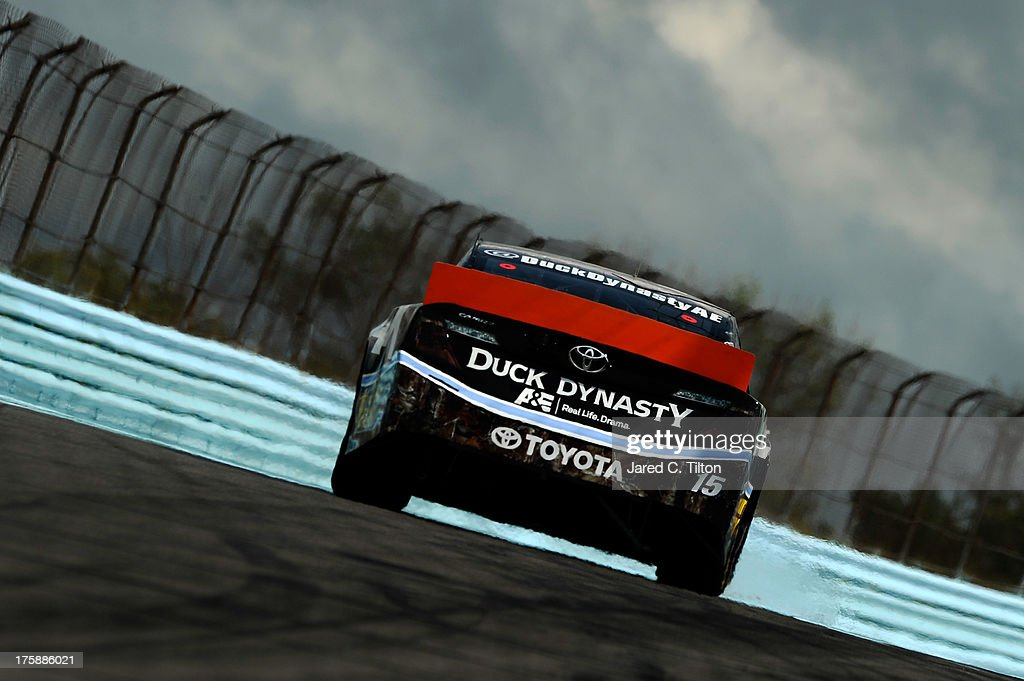 <a gi-track='captionPersonalityLinkClicked' href=/galleries/search?phrase=Clint+Bowyer&family=editorial&specificpeople=537951 ng-click='$event.stopPropagation()'>Clint Bowyer</a>, driver of the #15 PEAK/Duck Dynasty Toyota, during practice for the NASCAR Sprint Cup Series Cheez-It 355 at Watkins Glen International on August 9, 2013 in Watkins Glen, New York.