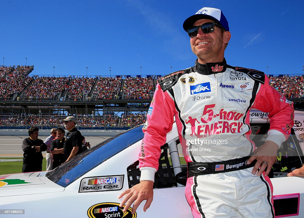 <a gi-track='captionPersonalityLinkClicked' href=/galleries/search?phrase=Clint+Bowyer&family=editorial&specificpeople=537951 ng-click='$event.stopPropagation()'>Clint Bowyer</a>, driver of the #15 Pink Lemonade 5Hr Energy benefiting LBBC Toyota, stands on the grid prior to the NASCAR Sprint Cup Series GEICO 500 at Talladega Superspeedway on October 19, 2014 in Talladega, Alabama.