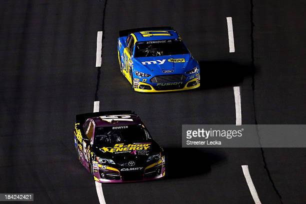 Clint Bowyer driver of the Raspberry 5hour ENERGY benefitting Living Beyond Breast Cancer Toyota leads Ricky Stenhouse Jr driver of the My Best Buy...