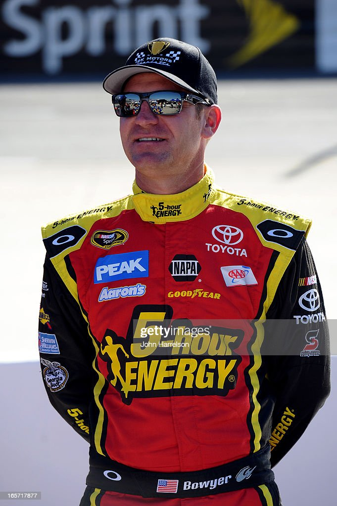 Clint Bowyer, driver of the #15 RK Motors Toyota, stands on the grid during qualifying for the NASCAR Sprint Cup Series STP Gas Booster 500 on April 5, 2013 at Martinsville Speedway in Ridgeway, Virginia.
