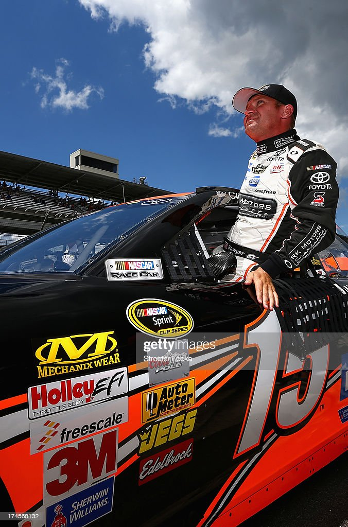 <a gi-track='captionPersonalityLinkClicked' href=/galleries/search?phrase=Clint+Bowyer&family=editorial&specificpeople=537951 ng-click='$event.stopPropagation()'>Clint Bowyer</a>, driver of the #15 RKMotorsCharlotte.com Toyota, climbs from his car after qualifying for the NASCAR Sprint Cup Series Samuel Deeds 400 At The Brickyard at Indianapolis Motor Speedway on July 27, 2013 in Indianapolis, Indiana.