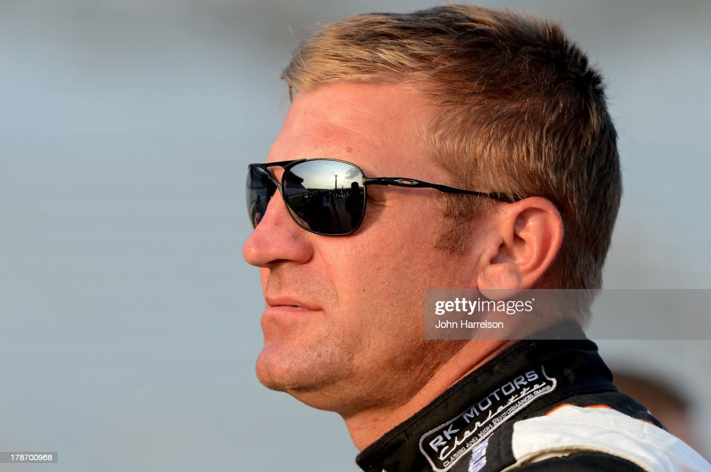 Clint Bowyer, driver of the #15 RKMotorsCharlotte.com Toyota,stands on the grid during qualifying for the NASCAR Sprint Cup Series AdvoCare 500 at Atlanta Motor Speedway on August 30, 2013 in Hampton, Georgia.