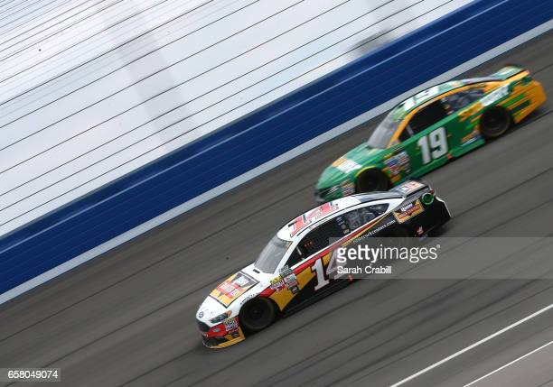 Clint Bowyer driver of the Rush Truck Centers Ford and Daniel Suarez driver of the Subway Toyota race during the Monster Energy NASCAR Cup Series...