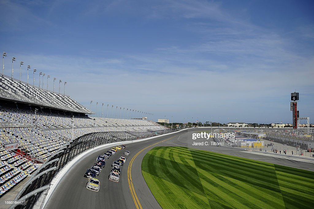 Clint Bowyer, driver of the #15 Toyota, leads a pack of cars through the tri-oval during NASCAR Sprint Cup Series Preseason Thunder testing at Daytona International Speedway on January 11, 2013 in Daytona Beach, Florida.