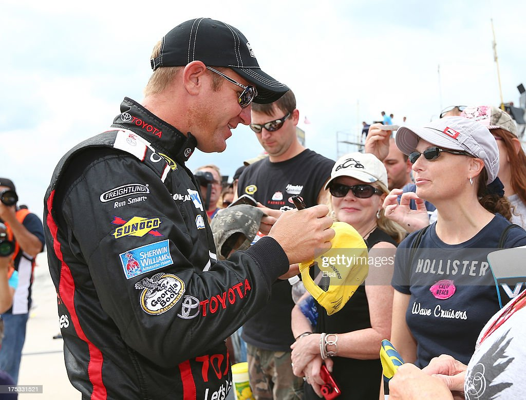 <a gi-track='captionPersonalityLinkClicked' href=/galleries/search?phrase=Clint+Bowyer&family=editorial&specificpeople=537951 ng-click='$event.stopPropagation()'>Clint Bowyer</a>, driver of the #15 Toyota Let's Go Places Toyota Camry Toyota, signs autographs during qualifying for the NASCAR Sprint Cup Series GoBowling.com 400 at Pocono Raceway on August 2, 2013 in Long Pond, Pennsylvania.