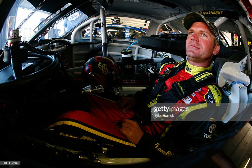 <a gi-track='captionPersonalityLinkClicked' href=/galleries/search?phrase=Clint+Bowyer&family=editorial&specificpeople=537951 ng-click='$event.stopPropagation()'>Clint Bowyer</a> sits in the #15 5-hour Energy Toyota before the start of practice for the NASCAR Sprint Cup Series AdvoCare 500 at Atlanta Motor Speedway on September 1, 2012 in Hampton, Georgia.