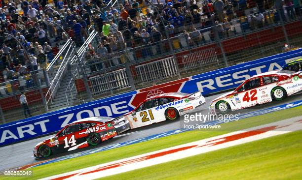 Clint Bowyer StewartHaas Racing HaasAutomation Ford Fusion leads during the Monster Energy NASCAR Cup All Star Race on May 20 2017 at the Charlotte...