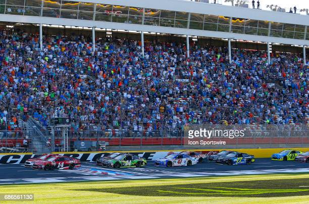 Clint Bowyer StewartHaas Racing HaasAutomation Ford Fusion leads the field to the green flag to start the Monster Energy Open on May 20 2017 at the...