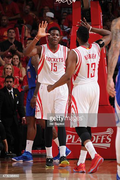 Clint Capela high fives with James Harden of the Houston Rockets after a play against the Los Angeles Clippers during Game Five of the Western...