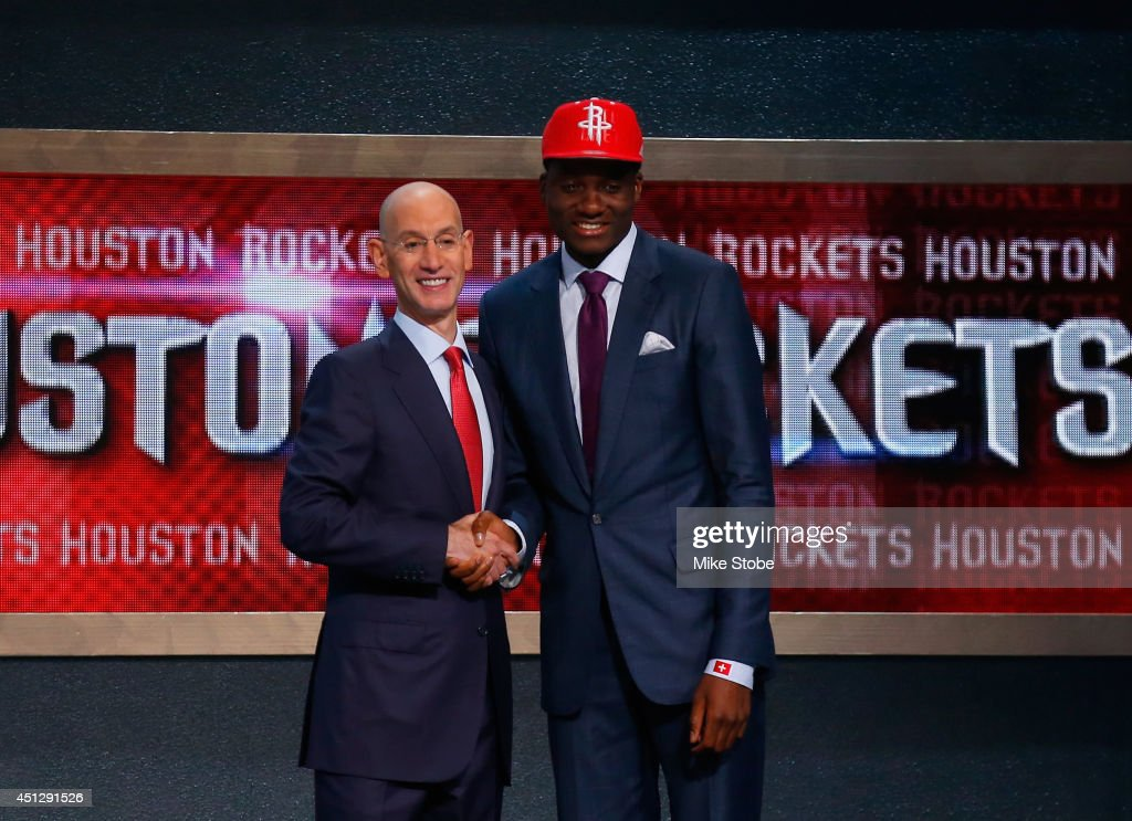 Clint Capela of France shakes hands with NBA Commissioner Adam Silver after being drafted with the overall pick by the Houston Rockets during the...