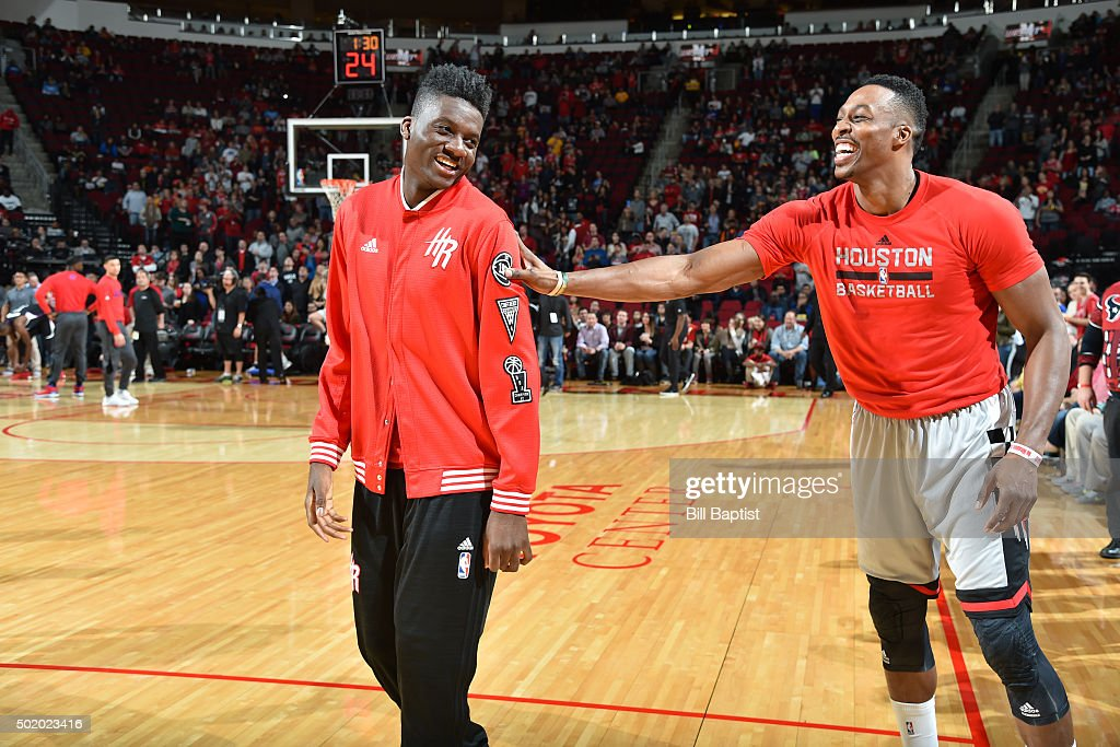 Clint Capela of the Houston Rockets and Dwight Howard of the Houston Rockets joke around before the game against the Los Angeles Clippers on December...
