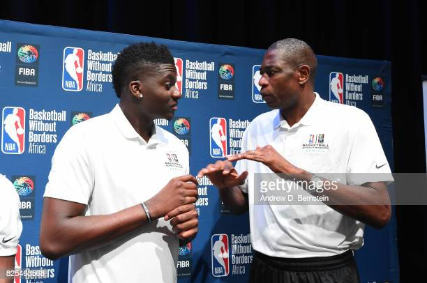 Clint Capela of the Houston Rockets and NBA Ambassador Dikembe Mutombo chats during the Basketball Without Borders Africa press conference at the...