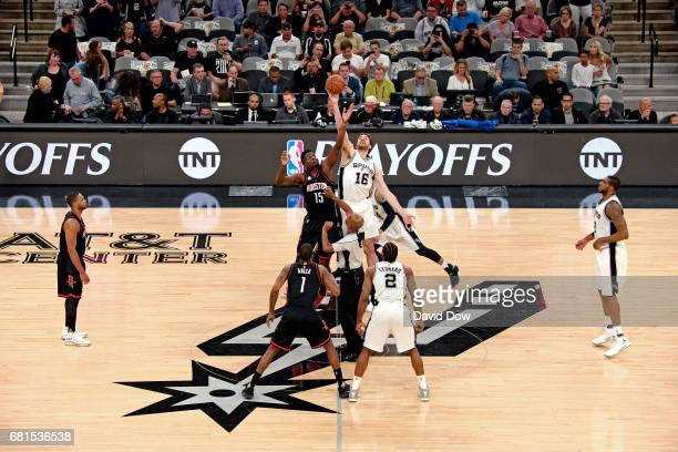 Clint Capela of the Houston Rockets and Pau Gasol of the San Antonio Spurs go up for the opening tip off before Game Five of the Western Conference...