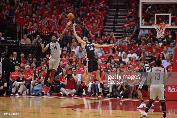 Clint Capela of the Houston Rockets and Pau Gasol of the San Antonio Spurs go up for a rebound in Game Six of the Western Conference Semifinals...