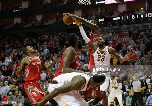 Clint Capela of the Houston Rockets blocks a shot by LeBron James of the Cleveland Cavaliers in the fourth quarter at Toyota Center on November 09...