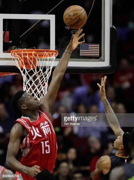 Clint Capela of the Houston Rockets defends a shot by Kent Bazemore of the Atlanta Hawks in the first half at Toyota Center on February 2 2017 in...