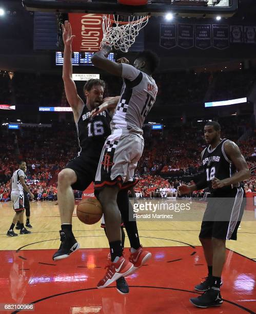 Clint Capela of the Houston Rockets defends against Pau Gasol of the San Antonio Spurs during Game Six of the NBA Western Conference SemiFinals at...
