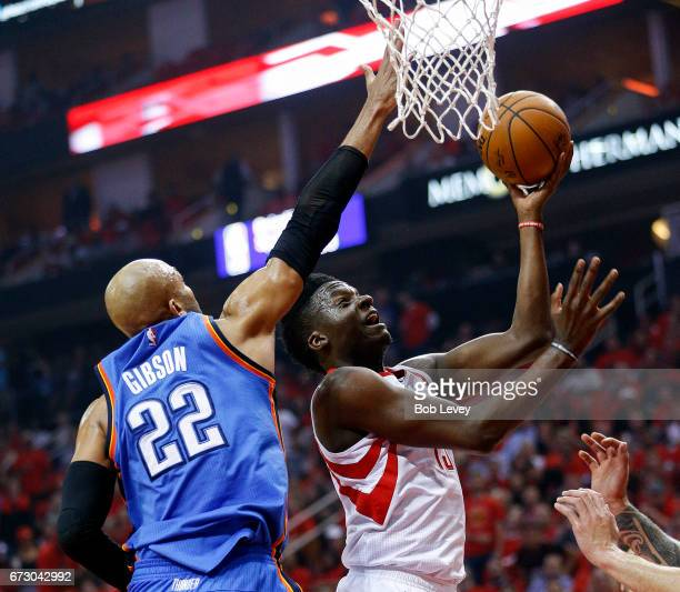 Clint Capela of the Houston Rockets drives past Taj Gibson of the Oklahoma City Thunder during the first quarter during Game Five of the Western...