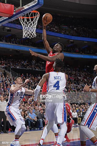 Clint Capela of the Houston Rockets drives to the basket and dunks the ball against the Philadelphia 76ers at Wells Fargo Center on January 27 2017...