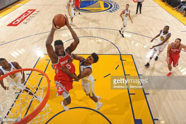 Clint Capela of the Houston Rockets drives to the basket and dunks the ball against the Golden State Warriors on October 17 2017 at ORACLE Arena in...