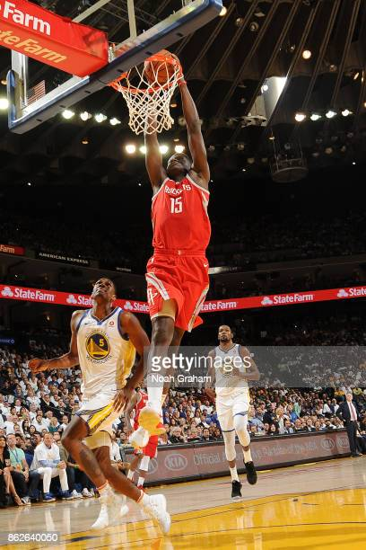 Clint Capela of the Houston Rockets dunks against the Golden State Warriors on October 17 2017 at ORACLE Arena in Oakland California NOTE TO USER...