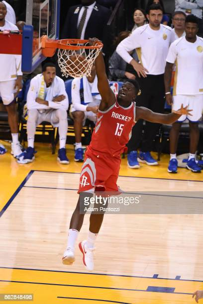 Clint Capela of the Houston Rockets dunks the ball against the Golden State Warriors on October 17 2017 at ORACLE Arena in Oakland California NOTE TO...