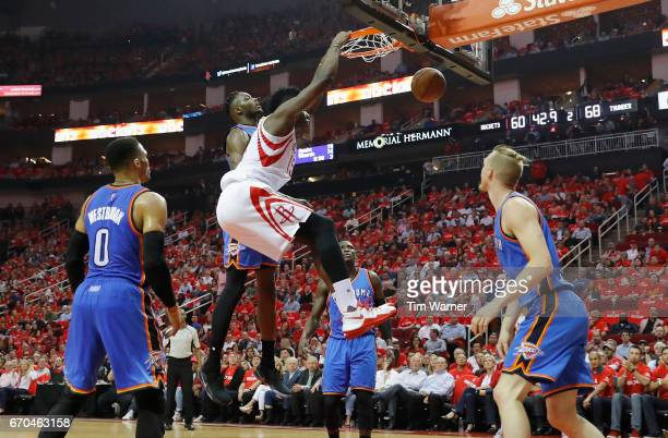 Clint Capela of the Houston Rockets dunks the ball defended by Jerami Grant of the Oklahoma City Thunder in the second half of Game Two of the...