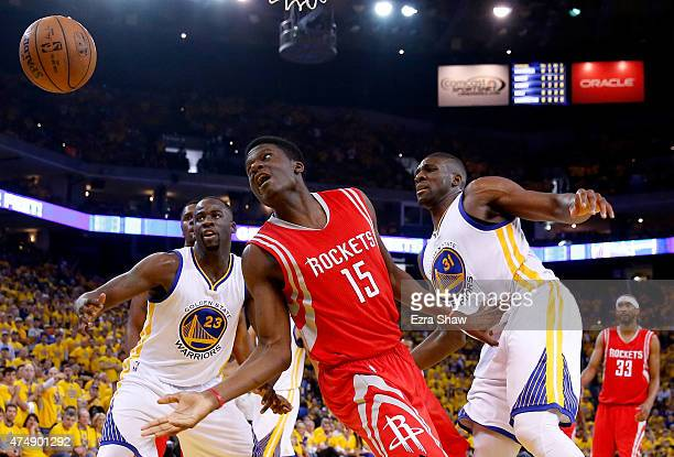 Clint Capela of the Houston Rockets goes after a loose ball between Draymond Green and Festus Ezeli of the Golden State Warriors in the first half...