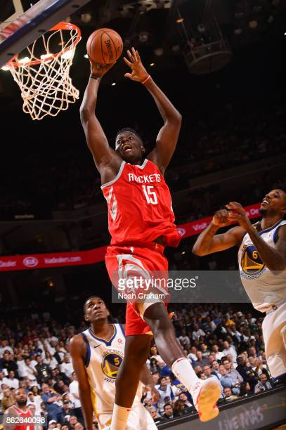 Clint Capela of the Houston Rockets goes to the basket against the Golden State Warriors on October 17 2017 at ORACLE Arena in Oakland California...