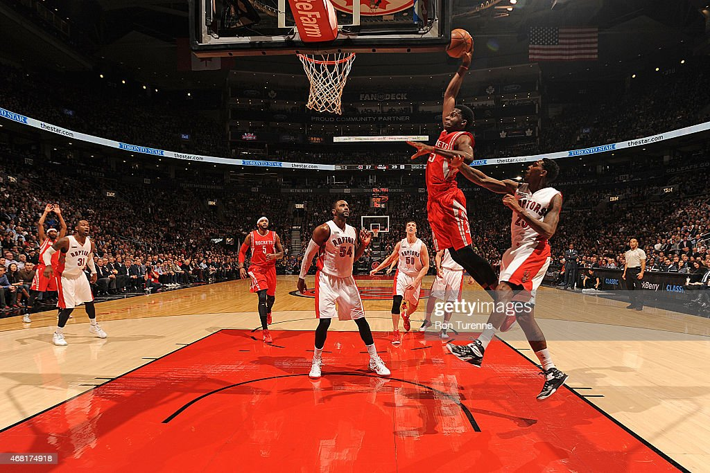 Clint Capela of the Houston Rockets goes up for a dunk against the Toronto Raptors on March 2015 at the Air Canada Centre in Toronto Ontario Canada...