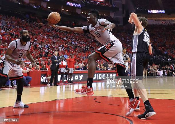 Clint Capela of the Houston Rockets grabs a rebound against Pau Gasol of the San Antonio Spurs during Game Six of the NBA Western Conference...