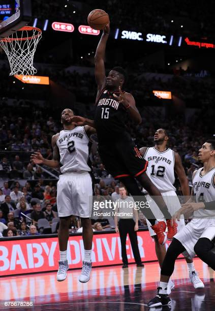 Clint Capela of the Houston Rockets makes the slam dunk against the San Antonio Spurs in the third quarter during Game One of the NBA Western...