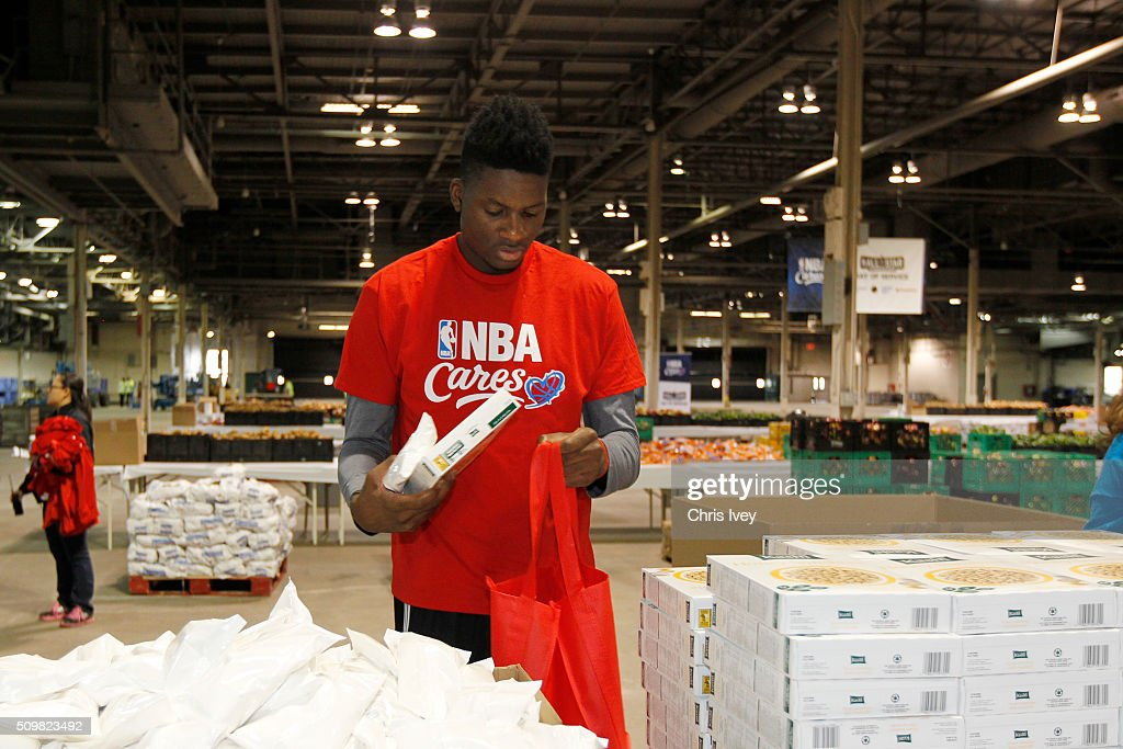 <a gi-track='captionPersonalityLinkClicked' href=/galleries/search?phrase=Clint+Capela&family=editorial&specificpeople=9889109 ng-click='$event.stopPropagation()'>Clint Capela</a> #15 of the Houston Rockets participates during the NBA Cares All-Star Day of Service as part of 2016 All-Star Weekend at NBA Centre Court of the Enercare Centre on February 12, 2016 in Toronto, Ontario, Canada.