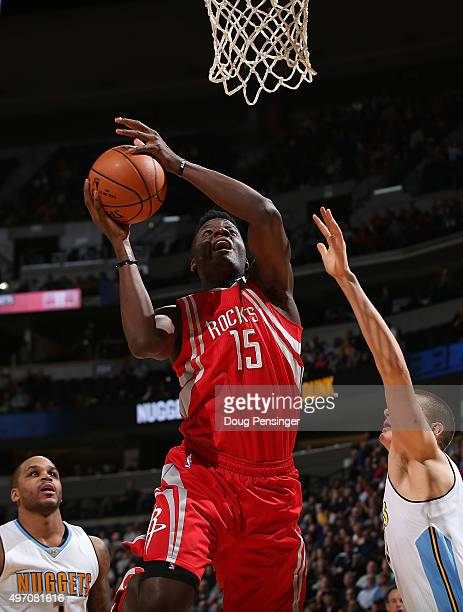 Clint Capela of the Houston Rockets puts up a shot against the Denver Nuggets at Pepsi Center on November 13 2015 in Denver Colorado The Nuggets...