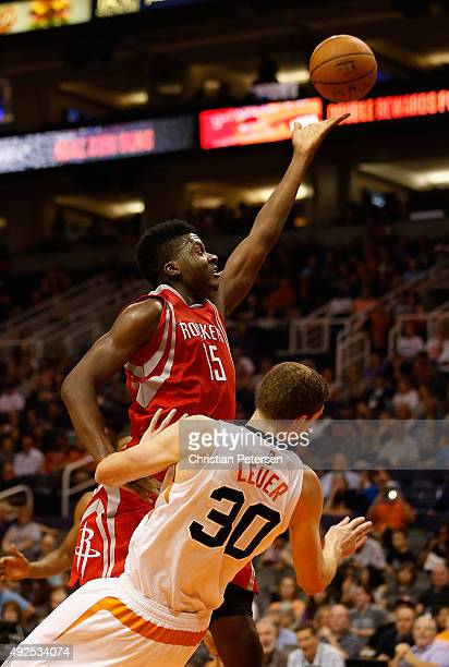 Clint Capela of the Houston Rockets puts up a shot over Jon Leuer of the Phoenix Suns during the first half of the preseason NBA game at Talking...