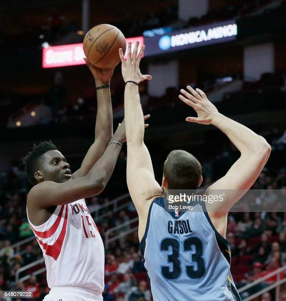 Clint Capela of the Houston Rockets shoots a jump hook over Marc Gasol of the Memphis Grizzlies during the second quarter at Toyota Center on March 4...