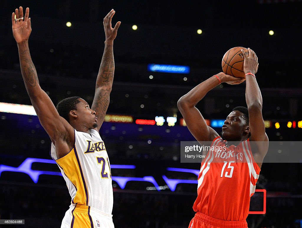 Clint Capela of the Houston Rockets shoots over Ed Davis of the Los Angeles Lakers at Staples Center on January 25 2015 in Los Angeles California The...