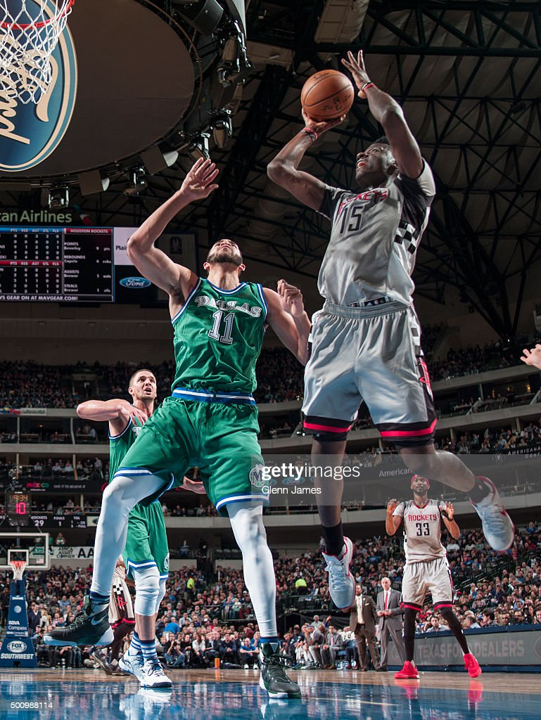 Clint Capela of the Houston Rockets shoots the ball against the Dallas Mavericks on December 4 2015 at the American Airlines Center in Dallas Texas...