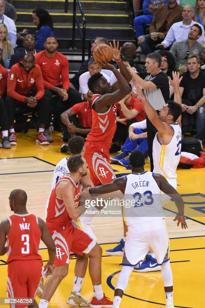 Clint Capela of the Houston Rockets shoots the ball against the Golden State Warriors on October 17 2017 at ORACLE Arena in Oakland California NOTE...
