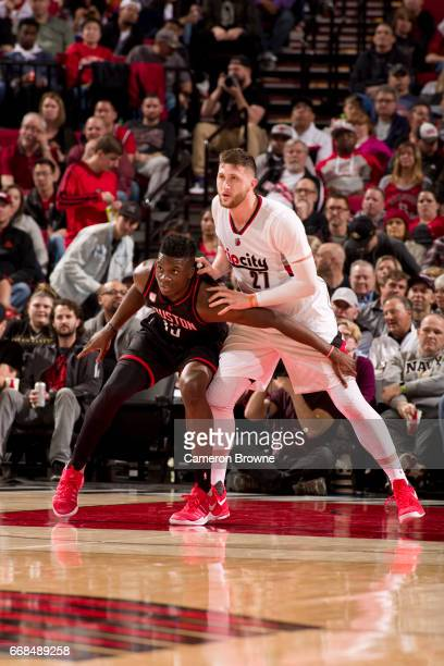 Clint Cappella of the Houston Rockets fights for the position against Jusuf Nurkic of the Portland Trail Blazers on March 30 2017 at the Moda Center...