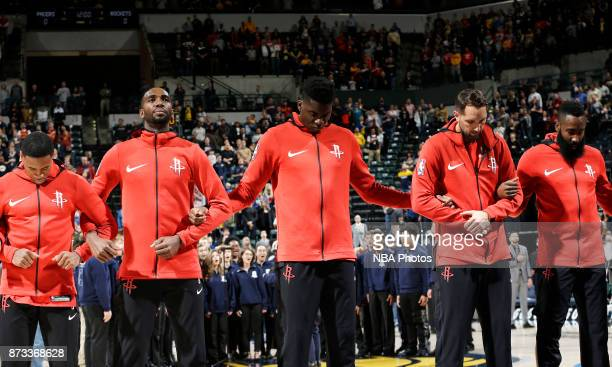 Clint Cappella of the Houston Rockets with his teammates stand for the National Anthem before the game against the Indiana Pacers on November 12 2017...