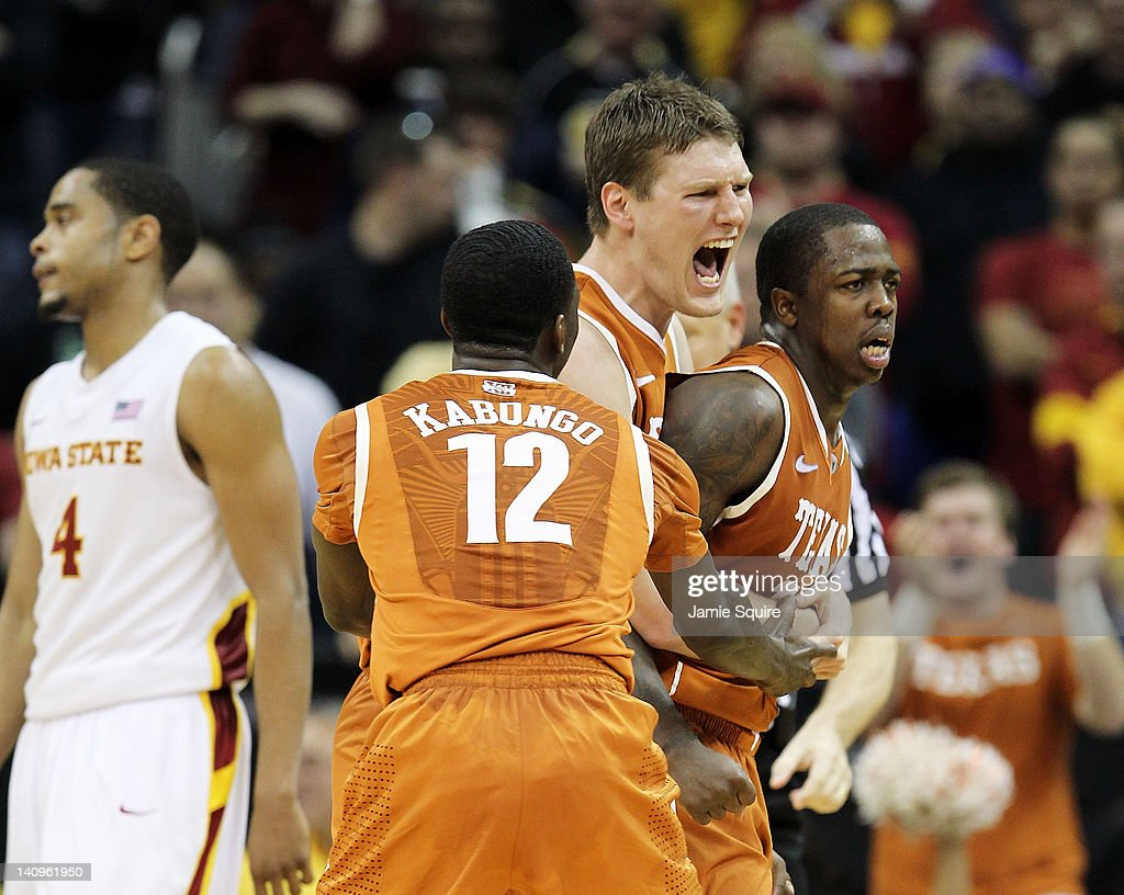 Clint Chapman #53 and Myck Kabongo #12 of the Texas Longhorns celebrate with J'Covan Brown #14 after Brown scored late during the NCAA Big 12 basketball tournament quarterfinal game against the Iowa State Cyclones on March 8, 2012 at Sprint Center in Kansas City, Missouri.