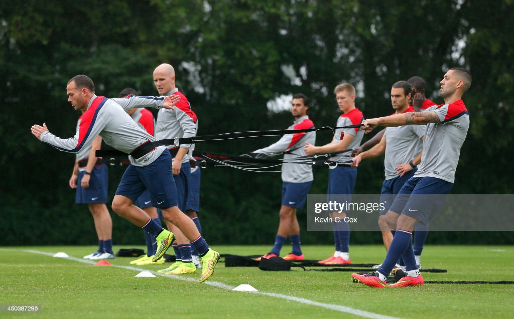 <a gi-track='captionPersonalityLinkClicked' href=/galleries/search?phrase=Clint+Dempsey&family=editorial&specificpeople=547866 ng-click='$event.stopPropagation()'>Clint Dempsey</a> and Brad Davis of the United States work out during their training session at Sao Paulo FC on June 10, 2014 in Sao Paulo, Brazil.