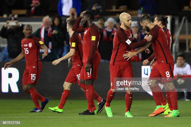 Clint Dempsey Darlington Nagbe Jozy Altidore Christian Pulisic congratulate Michael Bradley of the United States after he scored a goal against...