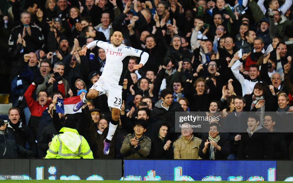 Clint Dempsey of Fulham celebrates a goal during the Barclays Premier League match between Fulham and Newcastle United at Craven Cottage on January...